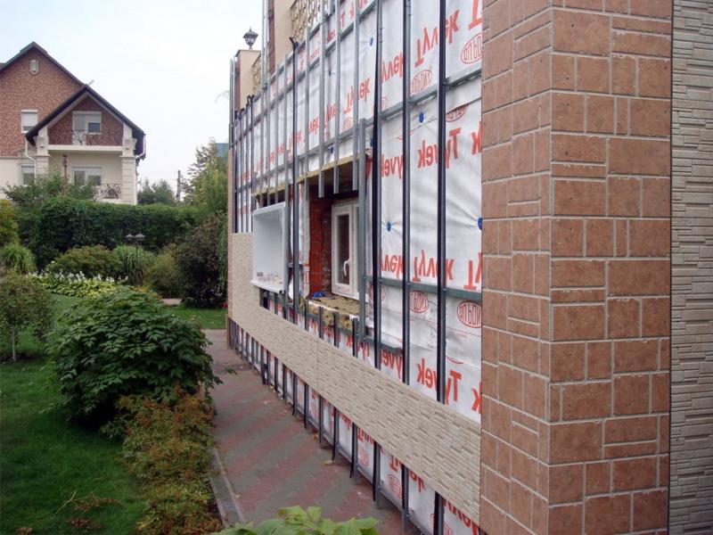 Внешняя отделка домов из бруса декоративными материалами класса люкс
